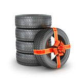 Tire with ribbon. Gift concept Royalty Free Stock Photography