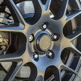 Tire rim with break pad showing between spokes royalty free stock images