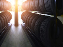 Tire rubber products , Group of new tires for sale at a tire store. Group of new tires for sale at a tire store Royalty Free Stock Photography