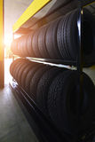 Tire rubber products , Group of new tires for sale at a tire store. Group of new tires for sale at a tire store Stock Photos