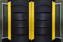 Tire rubber products , Group of new tires for sale at a tire store. Group of new tires for sale at a tire store Stock Photography