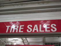 Tire sales. Tire sale shop in a super market royalty free stock photo