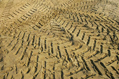 Tire in the sand Stock Image