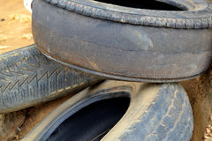 TIRE SELF COUNTERFEIT. Auto Tire counterfeit view that could not reach an average lifespan of about 30 000 km. Which explains its tear and endangers the lives of Royalty Free Stock Image