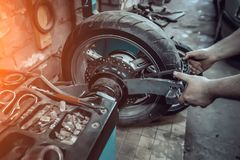 Tire service of a motorcycle wheel.  stock photography