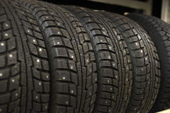 Tire shop. Large Metal Tires Rack. Modern Car Tire Service and Sale royalty free stock photography