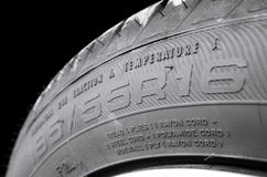 Tire size. Car tire sidewall showing size and type code royalty free stock photos