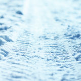 Tire in snow Stock Images