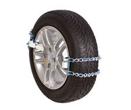 Tire with snow chain Stock Photo