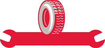 Tire With Spanner Wrench Retro Royalty Free Stock Photos