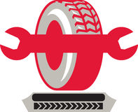 Tire With Spanner Wrench Retro. Illustration of a tire wheel with spanner wrench done in retro style Royalty Free Stock Photo