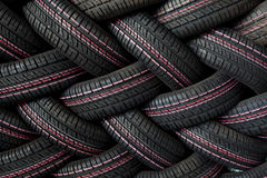 Tire stack background. Industrial tires in a stack. Ideal for backgrounds or manufacturing factories or distribution companies Stock Images