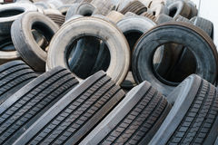 Tire stack background, used car ties selective focus Stock Photos