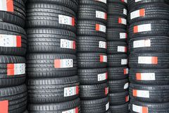 Tire store warehoouse with heap of summer tyre. In rows royalty free stock photo