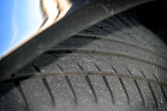 Tire Surface. Tire of a car in a parking lot Stock Image