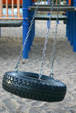 Tire Swing. At the playground Stock Photography