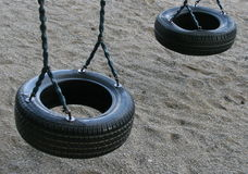 Tire swing for children. Two swings made of car tires Royalty Free Stock Images