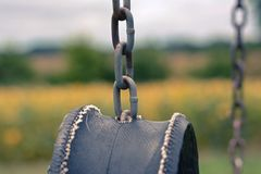 Tire swing on a farm Stock Photo
