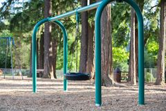 Tire swing for kids on the playground royalty free stock images
