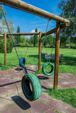 Tire swings. Empty tire swing set at playground royalty free stock photos