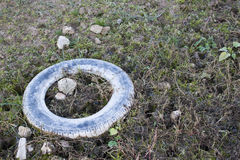 Tire throw away in a field Royalty Free Stock Photography