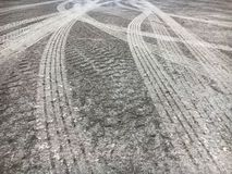 Tire tracks on cement rough road royalty free stock image