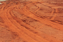 Tire track. On red clay royalty free stock photo