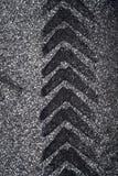 Tire Track on Asphalt. Single Tire Track on Asphalt stock images