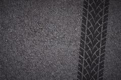 Tire track on asphalt Stock Photos