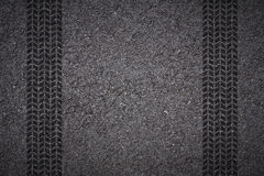 Tire track on asphalt. Tire tread pattern on asphalt background stock photos