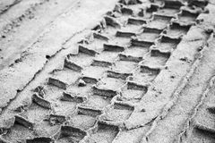 Tire track on gray sandy ground Royalty Free Stock Photos