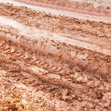 Tire track on lateritic soil Stock Images