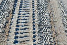 Tire track patterns on beach Stock Photos