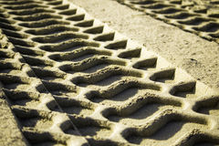 Tire track in the sand. Tire`s tracks printed in the sand Royalty Free Stock Images