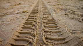Tire track on sand. A close up view of the track of a tire on a beach sand. Photo taken on September 21st, 2013 stock photos