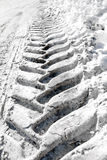 Tire track in snow Royalty Free Stock Photos