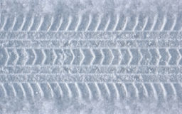 Tire track in the snow Royalty Free Stock Image