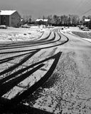 Tire Tracks. In the snow wit houses on the background Royalty Free Stock Photo