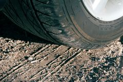 Tire and tracks. Automobile tire and tracks Royalty Free Stock Image