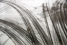 Tire tracks on asphalt Royalty Free Stock Photo