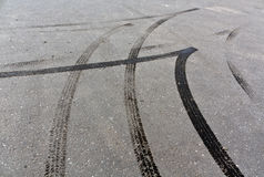 Tire tracks on asphalt. Royalty Free Stock Images