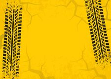 Tire tracks background with cracked and grunge effect. Black on yellow background. Vector Stock Photography