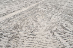 Tire tracks on the beach Royalty Free Stock Photography