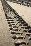 Tire tracks on a beach Royalty Free Stock Photos
