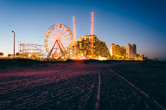 Tire tracks on the beach, rides and hotels at night, in Daytona Royalty Free Stock Images