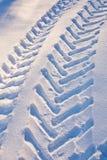Tire tracks car on snow Stock Photos