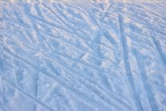 Tire tracks on clean, white snow on a Sunny and frosty winter day. chaotic motion. Tire tracks on clean, white snow on Sunny and frosty winter day. chaotic royalty free stock photos