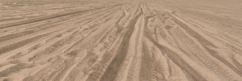 Tire Tracks Through The Desert Sand Royalty Free Stock Photos