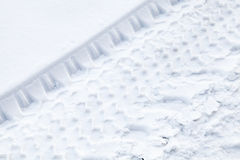 Tire tracks on fresh snow Royalty Free Stock Photo