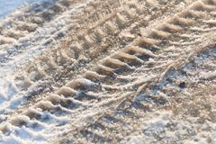 Tire tracks in the frozen snow - ice - detail. Frozen auto tyre tracks in the snow stock images